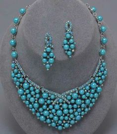 Blue Linked Rhinestone Bars and Pearl and Rhinestone Bib Set.