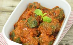 These meatballs have a healthy twist with plenty of spinach and a spicy sauce. This should definitely be your next dinner plan.