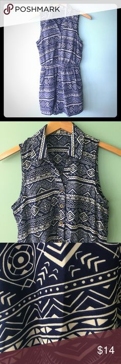 Tribal Print Romper Tribal print romper size small. Silky material. Navy and white. Button down front with elastic at waist. Pockets in shorts! Back has small keyhole opening above waistband. Pants Jumpsuits & Rompers