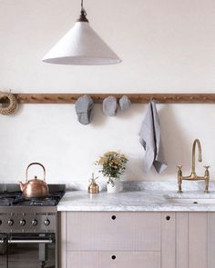 marble countertops and brass faucet in rustic modern kitchen. / sfgirlbybay
