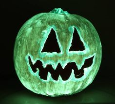 This is a glow in the dark pumpkin made using phosphorescent craft paint over a pumpkin. This is nice because there is no carving involved.
