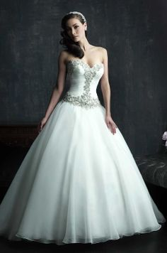 prettier satin ball-gown with more tool-like bottom and beading up center of chest and across sweetheart neck and belt; corset back with beading outlining