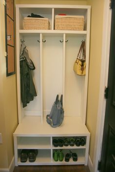 small mud room shelving; I wonder if I could get Garrett to build this into our basement hallway