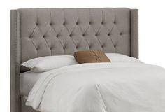 One Kings Lane upholstered gray linen tufted wingback headboard.  Lovely.