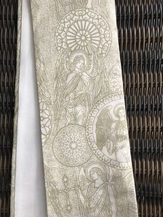 A personal favorite from my Etsy shop https://www.etsy.com/listing/598871915/reversible-goldoff-white-clergy-stole