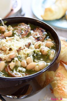 White Bean, Kale, Sausage Soup ~ a cozy, filling soup thats packed with nutrients and comes together in under 30 minutes! This soup was a great hit with my fiance and his friends! I added 5 slices of chopped bacon to add some extra manly flair! Party Knaller, I Love Food, Good Food, White Bean Soup, White Bean Sausage Soup, Sausage And Kale Soup, Veggie Sausage, White Beans, Cooking Recipes