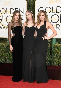 Sistine, Scarlet, and Sophia Stallone wearing glamorous black gowns. Sistine finished her look with Chanel ...