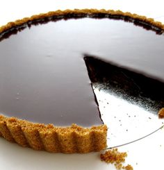 Dark Chocolate Tart - Dear Lord that looks good. Pouring cream or raspberries? ...Or both