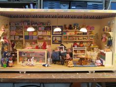 baby shop by goldieholl, via Flickr - other photos of this shop can be found on my Miniature TOYS...board.
