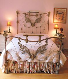 Beautiful antique iron bed with butterfly motif