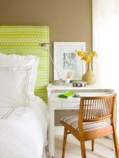 A simple white workstation doubles as a desk and nightstand. Get expert tips for decorating with color: http://www.bhg.com/decorating/color/colors/decorating-with-color-expert-tips/?socsrc=bhgpin082812whitedeskgreenroom
