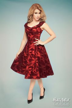 4b84c2906e5 Who doesn t look ravishing in red  This gorgeous red taffeta dress features  a flocked peacock print throughout
