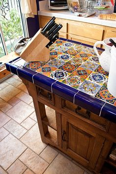 Beautiful Mexican tile island and prep table. Tile conserves resources, ie hardwoods to make butcher block top, or marble to make top. One layer of 3/4 inch marine plywood bonded to one layer of cement board to make a solid base for the tile.