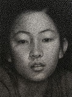 Japanese artist Kumi Yamashita creates mind-boggling portraits by wrapping a single UNBROKEN black thread around galvanized nails, on a clear white board.