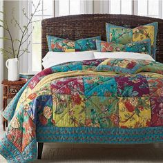 Chelsea Quilt / Sham - A celebration of color and pattern, our Chelsea patchwork quilt brightens the bed with tropical blooms in a palette of refreshing summer hues.