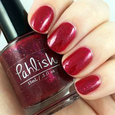 Pahlish - Bespoke Batch - Jelly Apple.  Inspired by Coney Island Jelly Apples, this polish is a vibrant candy apple red jelly with silver, gold, purple, and taupe flakes.