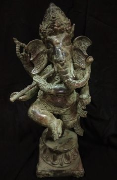 Items similar to Vintage Ganesh Statue 4 hands Bronze Brass - Hindu God Ganesha Spiritual Sculpture on Etsy Ganesh Statue, Ganesha, Flute, Meditation, Lion Sculpture, Spirituality, Bronze, Brass, God