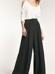 Black trousers with front darts detail. Wide cut, zip concealed by a placket and press studs fastening, two side pockets, two rear welt pockets and belt loops.