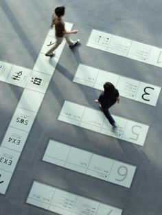 By Masaaki Hiromura, supervised the visual identity and the signage system. He introduced a unique signage system which does not spoil the transparency of the architecture (mainly made of glass) and in which information on the floor guides visitors to destination, without losing the transparency of the architecture or interfering with visitors looking at exhibits.