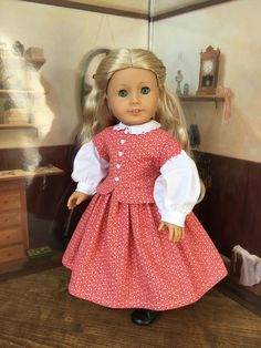 This dress reminds me of Miss Amy March from Little Women. The dress features a round collar trimmed with lace, a front placket with tiny little white