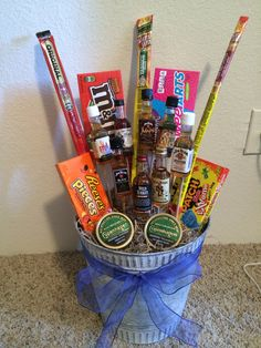 Valentines Day gift for my boyfriend. A man bouquet with whiskey mini shots, candy, slim Jim's, and his Copenhagen wintergreen chew.