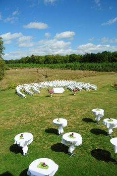 Circular seating at this Real Door County outdoor wedding. Photography by Art of Exposure. Location: Woodwalk Gallery.