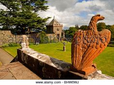 The garden and lawn at Torosay Castle near Craignure on the Isle of Mull in the Inner Hebrides western Scotland - Stock Image