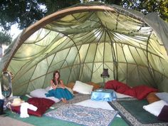 If you are camping, get creative with your options. Rugs, pillows, and a sweet shade structure add so much to your festival experience.