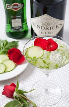 Basil Cucumber Martini ---- Ingredients: 3 oz. Hendricks Gin * .5 oz. dry vermouth * 1 pinch of salt * 1 pinch of sugar * 8 slices of English cucumber * 6 fresh basil leaves.  Preparation:-  Muddle basil and cucumber slices, shake with ice, and serve in a chilled martini glass. Garnish with cucumber slices and a rose bud.