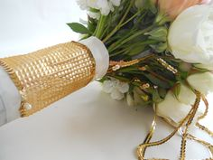 White, blush pink and gold bridal bouquet with white satin and gold rhinestone and sequin wrap