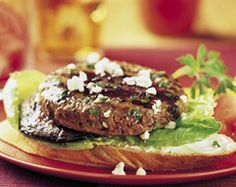Mushroom Merlot Burger -- Lean Ground Beef patties are grilled alongside portabello mushrooms and slices of French bread for a unique twist on a classic mushroom burger.