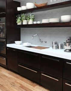 Black and white - thinking of doing something VERY similar with concrete countertops and darker orange walls. No backsplash because I will only have one or two long shelves and no upper cabinetry