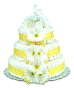 Pretty gerbera daisy flowers make this yellow diaper cake a great addition to any baby shower. Use it as a gift, or as a centerpiece! Order online http://www.favorfavorbaby.com/p-BBClassicYellow.htm