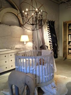 Luxury Dimgray Baby Cribs Warm Home Room Designed Unique Textured Grey Wall White Skirted Round Crib Chandelier
