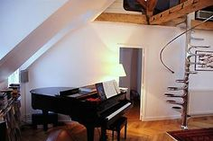 this Paris vacation rental comes with a Piano! #travel