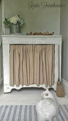 The drawers of the dresser we use for a vanity in the bathroom have been a hassle. Maybe we should pull the drawers out and do a curtain in front like this?