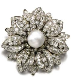 RosamariaGFrangini | Pearl Poetry | Natural pearl and diamond brooch, early 20th century. Designed as a flower set with a natural pearl and cushion-shaped diamonds.