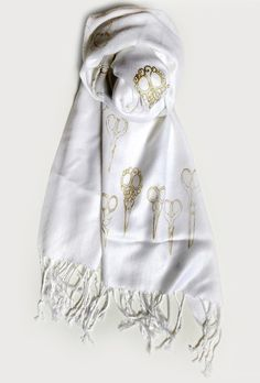 This exclusive gold scissors scarf is a quirky accessory alternative that we can't wait to wear.
