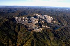 A mountain top removal mining operation sprawls over Guyandotte Mountain, West Virginia. This mountain's summit has been reformed and deformed, ...