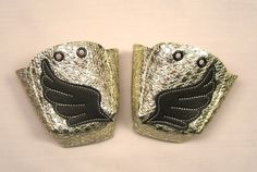 Gold leather Roller Derby skate toe guards with BLACK wings. £20.00, via Etsy.