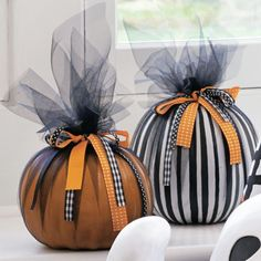 Clever Halloween and Thanksgiving decor is easy to create when you wrap pumpkins with netting and tie with varied ribbons. The result is gorgeous -- plus there is no carving or painting involved.