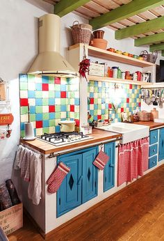 Cottage with a colorful eclectic kitchen.