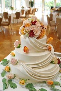 Elegant wedding cake design made with rolled fondant and sculpturing fondant.