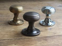 Reeded door knobs from British Ironmongery, shown in three different finishes: aged brass, antique brass and polished nickel. These door knobs are available in over twenty finishes and metals, including real, sand cast bronze. Each door knob is made in the UK and individually finished by hand. Available from - http://www.britishironmongery.co.uk/shop/reeded-cushion-door-knob/832.htm