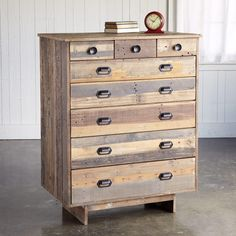 """TIOGA PASS DRESSER--Wood boards salvaged from rugged shipping pallets are repurposed by sleek design into a rustic patchwork at home in urban loft or country cottage. FSC-Certified reclaimed wood in earthy naturals, forged iron hardware. Three small and five large drawers. Imported. 38""""W x 22""""D x 48""""H."""