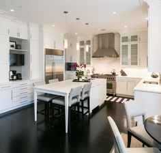 Marlene Dennis Design | Elm St | Bethesda, MD    #blackandwhitekitchen #blackandwhite #kitchen #kitchenrenovation #marble #eatinkitchen #modernkitchen #coffeestation #tvinkitchen