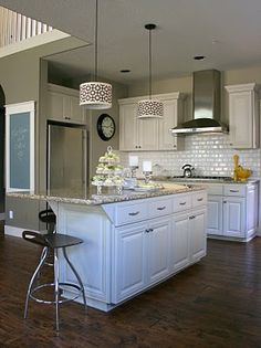 Nice!  Why I don't have white cabinets and a dark wood floor is a mystery.... it is all that I ever pin!!