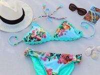 Pair of multicolored floral bikini beside white fedora hat Nebraska, White Fedora Hat, Beach Vacation Packing List, Types Of Suits, Tropical Fashion, Best Swimsuits, Summer Swimwear, One Piece Suit, Floral Bikini