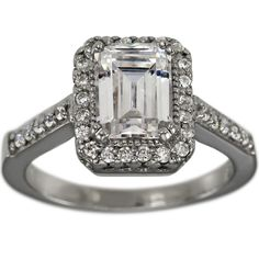 Vintage Emerald Cut Diamond Halo Engagement Ring Setting -  This is a Vintage Emerald Cut Diamond Halo Engagement Ring Setting. This ring can accommodate between a 1.25ct and 1.75ct emerald cut diamond. This emerald cut halo engagement setting is further enhanced with 0.38cts of brilliant round diamonds.  These sparkling round diamonds encircle the center stone and cover the shoulders of the shank. The characteristics of these rings are milgrain, engraving and open design work. The…
