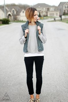 Stylist: Denim vest, gray tee, black denim and leopard sneakers